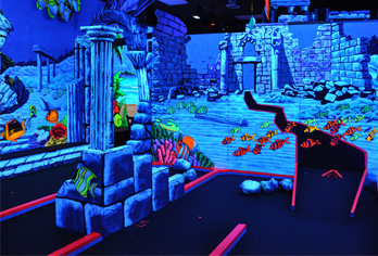 king neptune 39 s indoor blacklight mini golf virginia. Black Bedroom Furniture Sets. Home Design Ideas